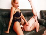 Golden-haired Dominatrix drilling constricted slave's anal opening with a hard rosy strapon