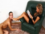 Beating Domme reading magazine while the serf is kissing her marvelous feet