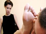 Powerful lad in a steel colar takes care of his Mistress' cute feet
