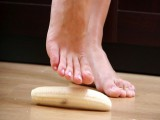 Inventive headmistress drops a banana on the floor and stomps it with her feet preparing the meal for her submissive