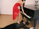 Tractable pianist lets his young raunchy student crush him while playing a glamorous tune